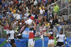 USA's Perry Baker catches the line-out ball in the men's rugby sevens match between Fiji and USA during the Rio 2016 Olympic Games at Deodoro Stadium on Aug. 10, 2016. | Best Photos From The Rio Olympics