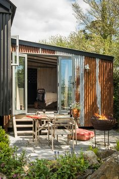 A Bohemian-Inspired Prairie Wagon That Makes a Unique Holiday Home - A rustic and homely holiday home in Cornwall, England - Tin House, Casas Containers, Shed Homes, Beach Shack, Tiny House Design, Tropical Houses, Architecture, Patio, House Styles