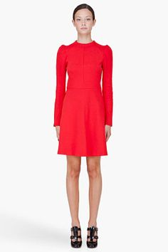 This long-sleeved dress hugs the skinniest part of the body: the waist. It flares out a little bit at the hips which evens out the difference between shoulders and wider hips in her triangle body shape. The dress accomplishes the purpose because it makes it look like the shoulders are bigger when, in reality, the hips are.