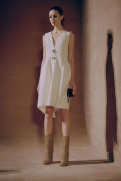 Here's an exclusive behind-the-scenes look backstage at Victoria Beckham's Fall 2015 runway show.