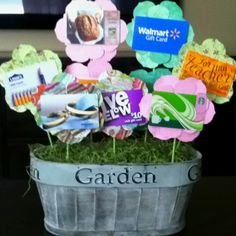 Teacher's end of year gift. All different gift cards in a basket of flowers.