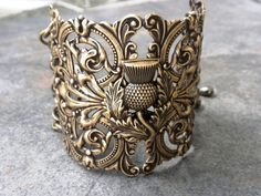 """Scottish Thistle Cuff brass filigree bracelet - """"The thistle has been the national emblem of Scotland since the reign of Alexander III (1249–1286) and was used on silver coins issued by James III in 1470."""" (Celts, Celtic, Scotland, history, jewelry)"""