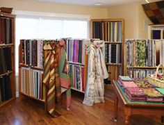 Quilters find green pastures at a well-established shop filled with fabrics and ideas. Quilting, Fabrics, Curtains, Store, Home Decor, Tejidos, Blinds, Decoration Home, Room Decor