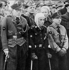 "Wounded flak crew.Wounded Hitler Youth ""flak helpers"", members of the ""flak generation"" of German children, receive the War Merit Cross, Second Class, 1944. Next year, they would be enlisting children even younger."