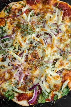 There are days I feel like I could solely blog about pizza and tacos. I find it beyond fun to come up with different combinations of toppings and fillings. The possibilities feel endless. This fennel pizza is a perfect example of what winter pizza looks like in our house. The flavor of fennel is uplifting [...] The post Spinach Fennel Pizza appeared first on Naturally Ella. :: Food