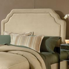 Wood-framed headboard with buckwheat velveteen upholstery and nailhead trim.  Product: HeadboardConstruction Materia...