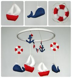 Nautical sailboat mobile-navy blue, red and white.    This gorgeous nautical mobile is suitable for any boy or girls room who loves boats, the