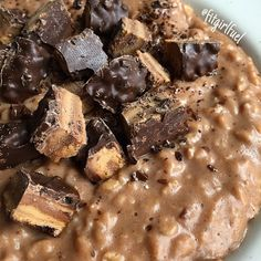 50g rolled oats cooked in water, then added 65g canned pumpkin purée and 1/2c liquid eggs whites stirred in & cooked until fluffy. 1 Tbsp cocoa powder, dash of butter extract, and vanilla stevia for flavor. Then added 15g @pescience cookies & cream protein. Topped with a chopped up protein bar... SO GOOD.  This is my first meal of the day (post workout = mostly carbs and protein). I didn't eat before I lifted, just took @pescience high volume + alphamine and sipped on Amino IV during.