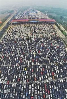 Vehicles are seen stuck in a traffic jam near a toll station