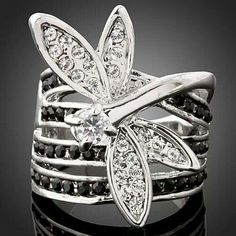 Something like this would be my perfect wedding ring! No black stones tho...