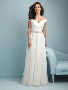 Allure Bridals, 9211; For this gown we draped airy tulle throughout for a soft, graceful effect. The off-the-shoulder sleeves add a romantic flourish.
