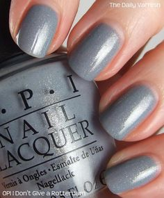 OPI I Don't Give a Rotterdam! On my nails it looks more like a slate grey with a golden shimmer.