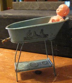 A lovely antique German toy bathtub on legs with an antique celluloid baby doll included. The tub is marked D.R.G.M. on the bottom. Late 1800s early