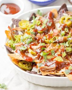 Use up your leftover meat from those summertime BBQs and make these easy Pulled Pork BBQ Nachos. Ready to devour in under 20 minutes!