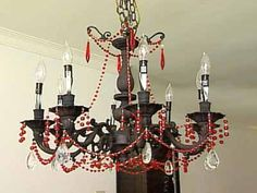black chandelier with red beads and large crystals in baroque period interior decorating style