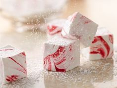 Peppermint Marshmallows  IngredientsButter for greasing1/3 cup powdered sugar21/2 tablespoons unflavored gelatin1/2 cup cold water11/2 cups granulated sugar1 cup corn syrup1/4 teaspoon salt1/2 cup water1 teaspoon pure peppermint extract8 to10 drops red food color Directions:Generously grease bottom and sides of 11x7-inch (2-quart) glass baking dish with butter; dust with 1 tablespoon of the powdered sugar. In bowl of stand mixer, sprinkle gelatin over 1/2 cup cold water to soften; se