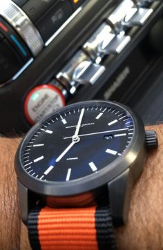 Maurice de Mauriac L1 watch with Nato strap inside the latest Ford Mustang. Swiss high quality watches for men and women.