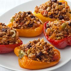 Bell peppers are filled with a Cuban picadillo stuffing of rice, ground beef, tomatoes, raisins and Spanish olives.