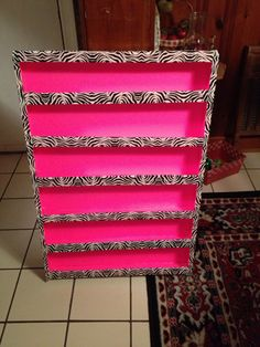 DIY Nail Polish Rack. Made from neon pink foam board, zebra duct tape and lots of hot glue!