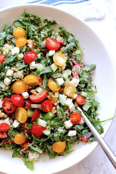 Quinoa salad with cherry tomatoes and cucumbers. An easy, colorful, summer salad that is the perfect side dish or main meal on a hot day. It features quinoa, fresh summer veggies, peppery arugula and feta cheese. Fresh Salad Recipes, Healthy Salad Recipes, Clean Recipes, Whole Food Recipes, Vegetarian Recipes, Yummy Recipes, Free Recipes, Dinner Recipes, Yummy Food
