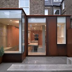 Corten - weathered steel. McLaren Excell adds a weathered-steel and concrete extension to a London house