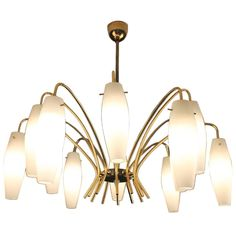 Mid-Century Modernist iItalian Opaline Glass and Brass Chandelier | See more antique and modern Chandeliers and Pendants at https://www.1stdibs.com/furniture/lighting/chandeliers-pendant-lights