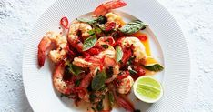 This recipe comes from Liberté restaurant in Albany, Western Australia. It marries fresh Australian prawns with a heady amount of garlic, the fragrance of Thai basil and an extra kick from red chillies. Best shared with friends on a sunny day. Prawn Recipes, Chilli Recipes, Chef Recipes, Seafood Recipes, Seafood Dishes, Savoury Recipes, Fish Dishes, Recipes Dinner, Fish Recipes