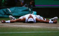 Flat out: Rafael Nadal celebrates after finally beating Roger Federer in the 2008 Wimbledon finalPhoto: GETTY IMAGES