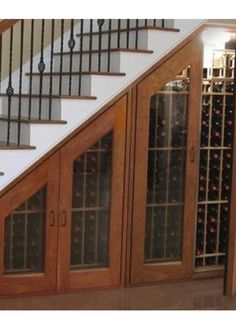 Classic under stairs storage with an awesome win shelf and wooden framed glass doors