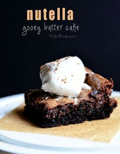 I ❤ Anything with Nutella!  Nutella Gooey Butter Cake  ㋡ 1 (18¼ oz) Box Duncan Hines Dark Chocolate Fudge Cake Mix; 1 large Egg, ½ cup butter, melted ㋛ Filling: 8 oz cream cheese, softened; 2 large eggs beaten; 1 cup Nutella; 1 tsp vanilla; 2 cups powdered sugar
