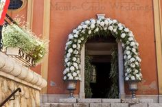 Flower arch for the church entrance. Wedding by Monte-Carlo Weddings