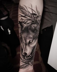 blackwork wolf tattoo on forearm by Britannia Adelphi Hotel