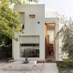 This house in Argentina by local architectsArquinoma has a front door tall enough to let in a giraffe. Located in the city ofMendoza, the two-storeyCasa Besares is a white-rendered, rectilinear building with wooden floors and a concrete frame. Square and rectangular windows are scattered across the facades, while awooden staircase folds up between the floors.