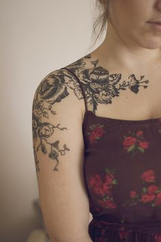 Black and white flower tattoo on the shoulder and chest. Not quite a half sleeve