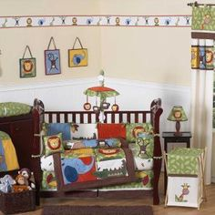 Jump into the jungle with this adorable crib bedding set featuring detailed monkeys, lions, giraffes, crocodiles and elephant jungle themed appliqués and embroidery works. This collection uses the stylish colors of green, blue, orange, brown, yellow, red, and ivory.