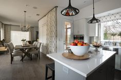 The open plan kitchen leads to a dining room with a table for six, making it easy to prepare a meal in the kitchen while setting the dining table for dinner.