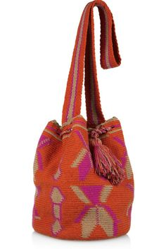 Wayúu Tayá Mochilla hand-sewn crossbody bag: bright-orange, fuchsia and sand knitted cotton, woven strap, tasseled sides and drawstring, wooden embossed Wayúu Tayá Foundation tag. Drawstring top. Each bag is handmade and totally unique. Product may differ from that pictured.