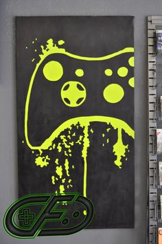 Perfect for any game room or man cave! This is a hand painted picture of an Xbox 360 Controller with splatter details. It is acrylic paint on