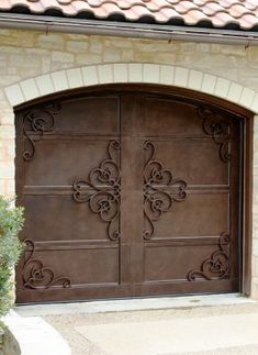 Cantera Doors provides hand-forged, custom-made iron staircase & balcony railings for your home in Texas & Florida. House Main Gates Design, Door Gate Design, Garage Door Design, Hacienda Style Homes, Spanish Style Homes, Garage Door Styles, Metal Garage Doors, Iron Staircase, Porte Cochere