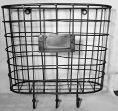 These little baskets are just perfect for small or tight spaces (like that little sliver of wall between the front door and window) to hold mail, gloves or cell phones. The hooks are super handy for k