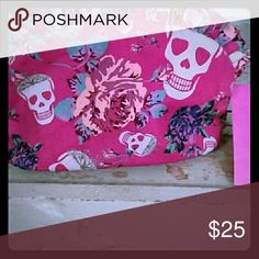 Betsey Johnson skull and roses cosmetic bag Printed bag with hot pink background. Ruffle top with zipper.In good condition Betsey Johnson Bags Cosmetic Bags & Cases