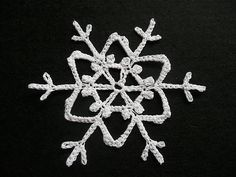 Snowflake #34 - Pattern from 60 Crocheted Snowflakes by Barbara Christopher