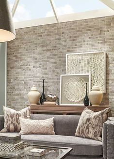Beautiful tan and gray pallet with brick wall.  Farmhouse style.
