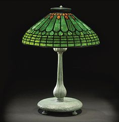 A TIFFANY STUDIOS JEWELED FEATHER LEADED GLASS LAMP SHADE, CIRCA 1910
