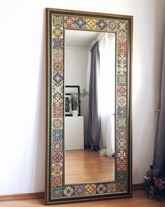 Image may contain: indoor Mirror Decor Living Room, Bedroom Decor, Wall Decor, Home Decor Furniture, Painted Furniture, Spanish Home Decor, Tile Crafts, Interior Decorating, Interior Design