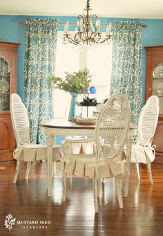 Dining Room - Love that shade of blue with the shabby white dinette.  Great chandelier too.