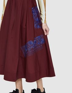 Loose-fitting skirt from Acne Studios in Red Wine. Ultra high rise. Paperbag waist with gathered elastic back and drawstring adjustment. On-seam side pockets. Cuban-inspired embroidery. Long-thigh length.  •Italian Poplin •100% cotton •Dry clean