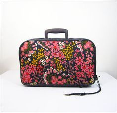This is what my first suitcase looked like, no wheels back then.  And the handle, etc was a sky blue not this darker color.