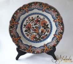 A truly wonderful and LARGE Royal Makkum Tichelaar polychrome wall plate / charger / cabinet plate. Vtg Dutch FRISIAN pottery (deep) wall hanging plate with a scalloped rim showing a bird pattern and a lovely floral motive. Entirely hand-painted. On offer by SoVintastic on Etsy!