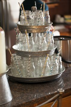 Adorable way to display mason jar drinking glasses at this baby shower!